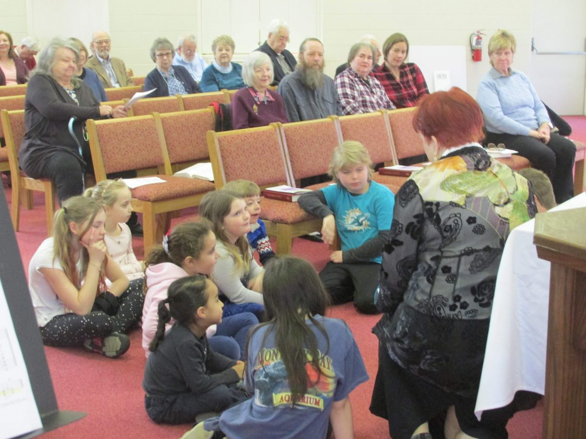 Children sit for the Bible Story at The Gayton Kirk Presbyterian Church in Richmond's West End